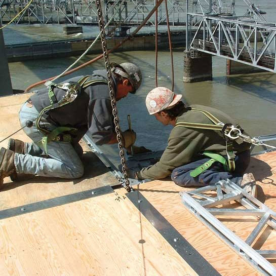 quikdeck-men-working-with-pins
